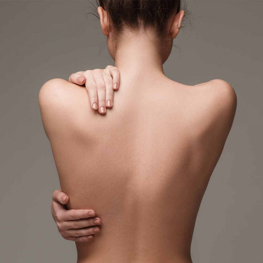 woman-back-hands-skin