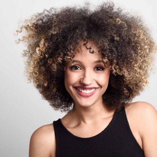 woman-smiling-shoulders-hair